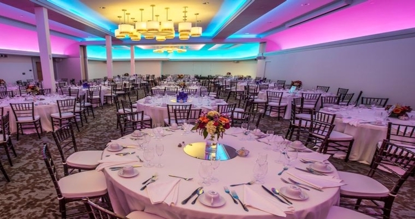 The Culpeper Center's ballroom showing bright LED lighting, set up before an event.