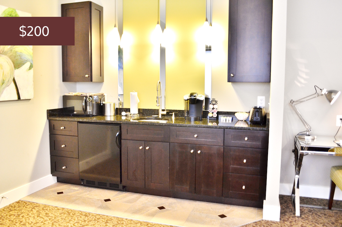 Showing the wet bar, the Luxury Suite with Kitchenette rents for $200 per night.