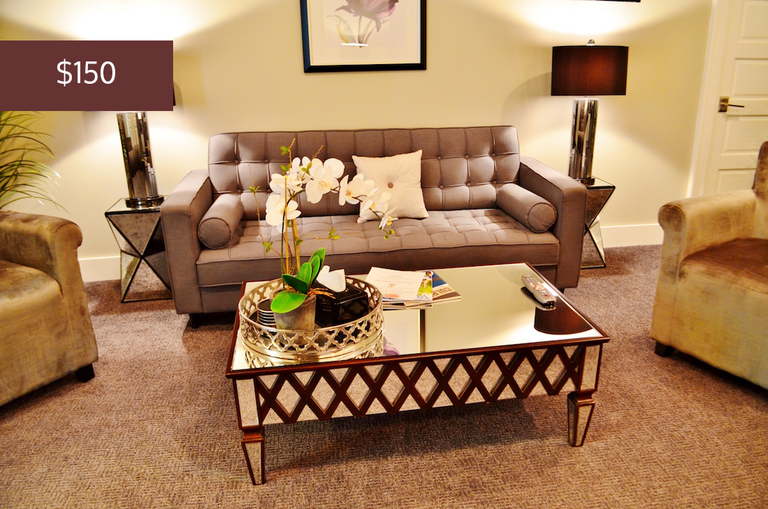 Showing the sitting room, the cost of the Studio Suite is $150 per night.