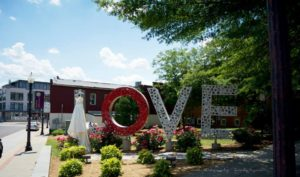 Photo showing downtown Culpeper's love statue, spelled out L O V E.