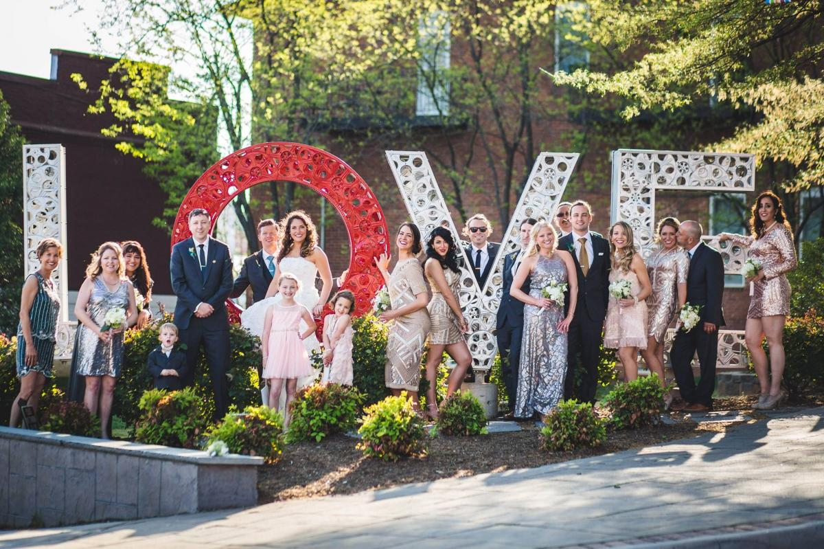 This is a photo of a bridal party standing near the LOVE statue in Culpeper, VA.