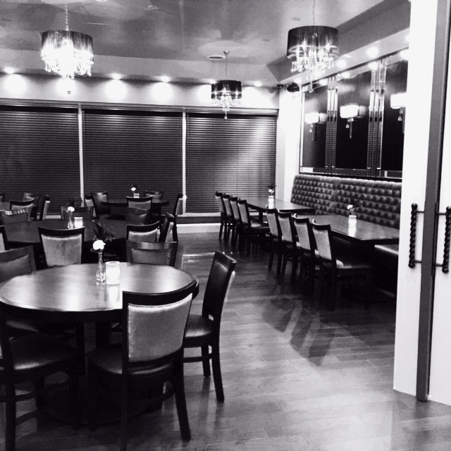 This is a black and white photo of the Gatsby Room at the Culpeper Center.