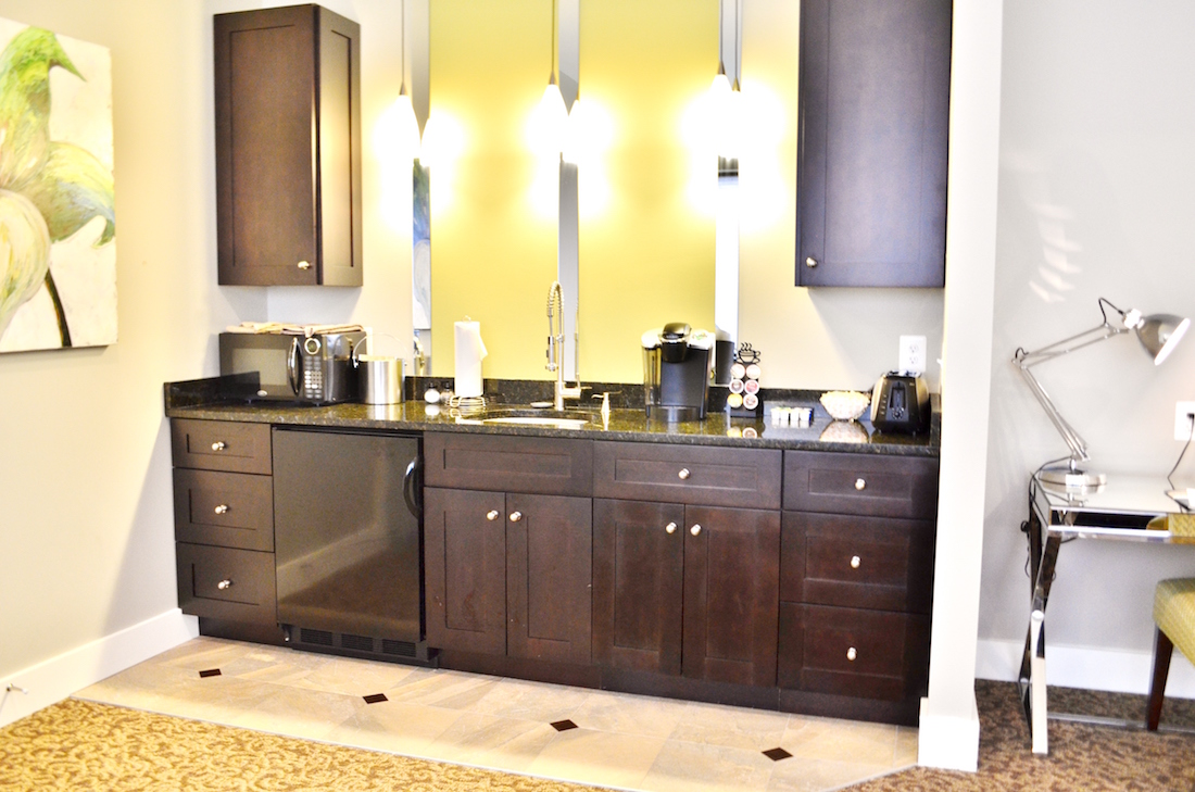 This is a photo of the entire wet bar of the Luxury Suite with Kitchenette at the Culpeper Center.