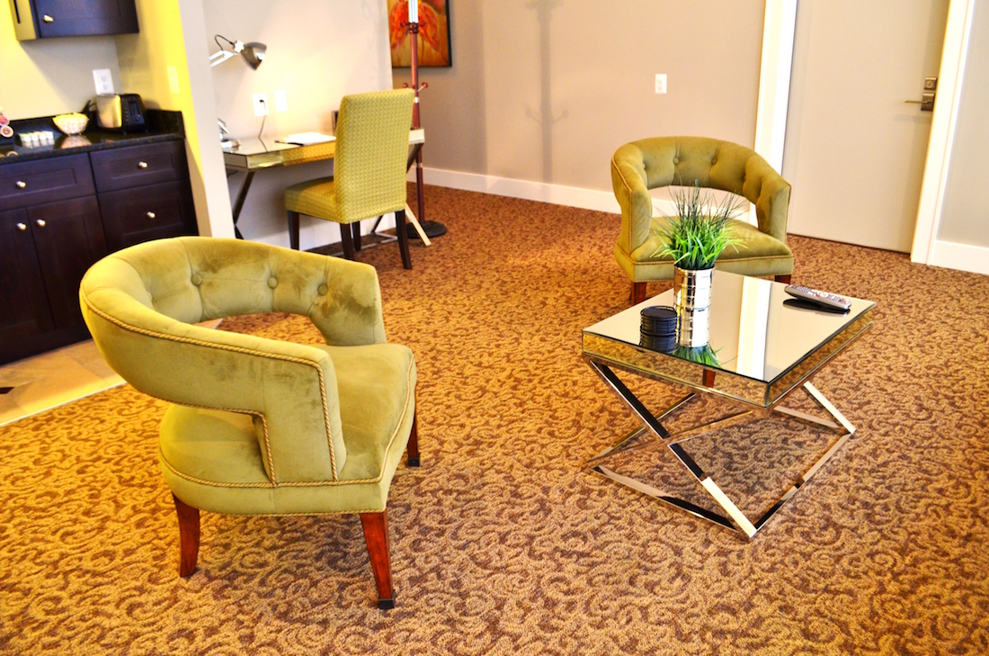 This is a photo showing the sitting room of the Luxury Suite at the Culpeper Center.